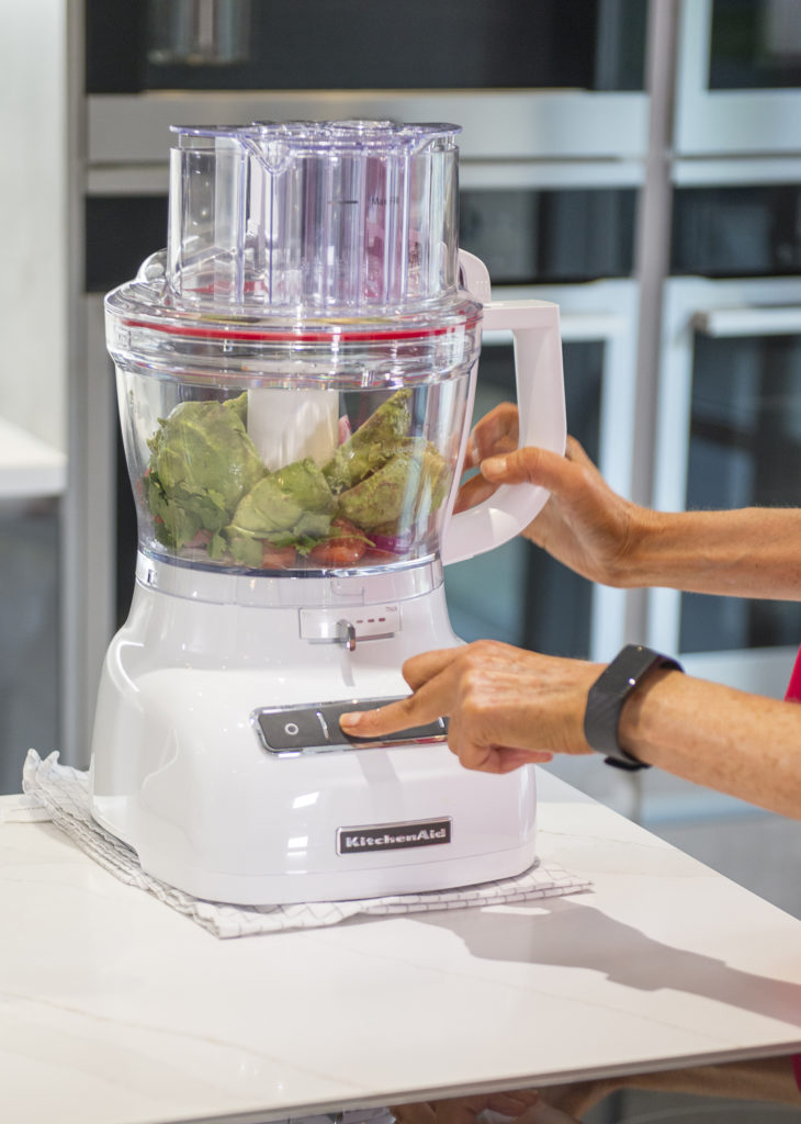 Place the chopped avocados and tomatoes into a food processor with the juice of the lime, chopped red onion and deseeded and chopped chilli and pulse.
